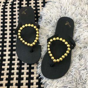 sanuk ibiza black gold flip flop 7/8